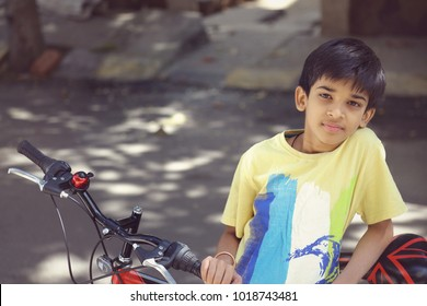 Indian Cute Boy with Cycle