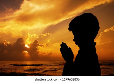 Indian Cute Boy Praying on Beach
