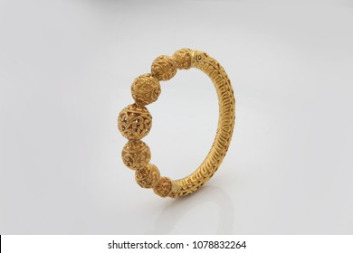 Gold Bangles Images, Stock Photos & Vectors | Shutterstock