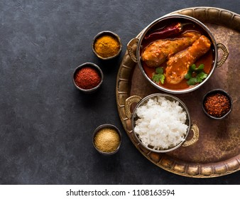 Indian dish chicken spicy curry masala. Spicy chicken legs with rice