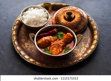 Indian dish Spicy Chicken Curry. Spicy chicken legs with rice