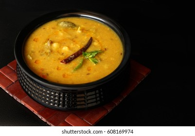 Indian dish vegetable daal,Daal Curry,traditional Indian soup on black background