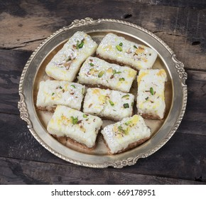 Indian Diwali Sweet Food Kalakand Also Know as Halwa or Mawa Kalakand is a Creamy Delicacy Made From Paneer or Cottage Cheese, The Dish Originated in Alwar, Rajasthan. Kalakand on Wooden Background