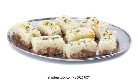 Indian Diwali Sweet Food Kalakand Also Know as Halwa or Mawa Kalakand is a Creamy Delicacy Made From Paneer or Cottage Cheese, The Dish Originated in Alwar, Rajasthan. Isolated on White Background