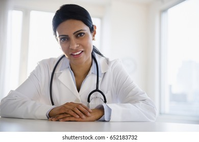 Indian doctor talking in office