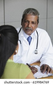 Indian doctor talking to patient