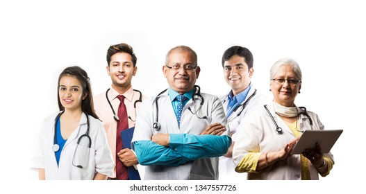Indian doctors in group, standing isolated over white background with hands folded and wearing uniform and stethoscope and chart