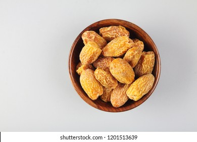 Indian dry dates in a wooden bowl
