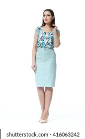 indian eastern brown hair business executive woman with straight hair style in blue skirt and floral sleeveless blouse high heel shoes going full body length isolated on white