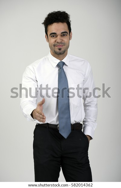 Indian employee extending his right hand to shake hands