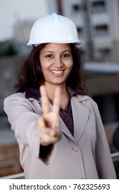 Indian engineer woman show Victory sign