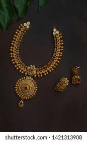 indian ethnic jewellery on dark background