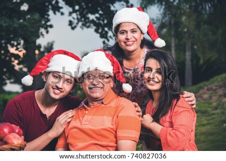 indian family celebrating christmas and posing for a group photo three generations of indian family