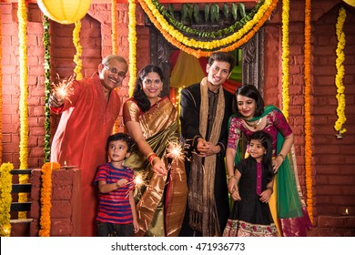 Indian Family celebrating Diwali festival with fire crackers