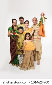 Indian family celebrating Gudi Padwa or Ugadi festival, which is a new year in Hindu tradition