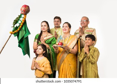 Indian family celebrating Gudi Padwa or Ugadi festival while lady or wife holding Puja or pooja thali, It's a new year in Hindu Religion