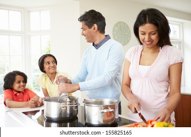 Indian Family Cooking Meal At Home