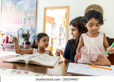 Indian family do drawing on book