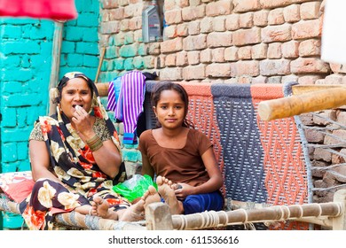 Indian family on his doorstep. Portrait parents with children home. India, Govardhan, November 2016