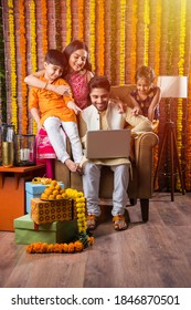 Indian family online shopping using laptop and debit ot credit card on diwali festival