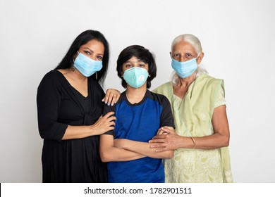 An Indian family wearing face mask for protection against Covid-19,