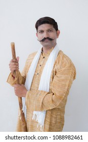 indian farmer holding stick