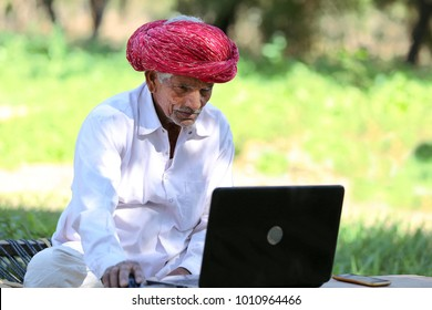 Indian farmer loves Technology, Working on laptop. No Age to Learn. Happiness in Learning. Age no Bar for Learning.Great scope of technology in rural India. Technology penetrates Indian villages.