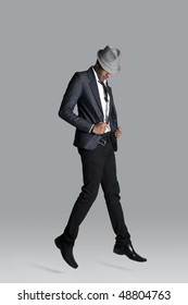 Indian fashion model holds onto his suit jacket as he floats upward