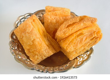Indian favorite savoury puff pastry popularly known as 'Khari Biscuits' is a favorite breakfast snack or anytime snack which goes very well with a hot cup of plain or spicy (masala) tea.