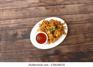 Indian Favourite Street Fried Food Pakora Also Know as Pakoda, Fried Onion PakoraBhajiya, Rava Bhaji, Kanda Bhaji, Pyaz Pakoda, Fried Chillies Served with Chutney