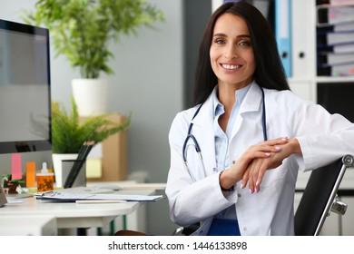 Indian female adult doctor portrait aganist hospital office backround. Medical education concept