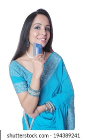 Indian female smiling with a credit/ debit card.