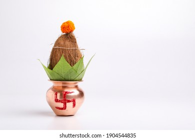 Indian festival akshaya tritiya concept : Decorative kalash with coconut and leaf with floral decoration - Shutterstock ID 1904544835