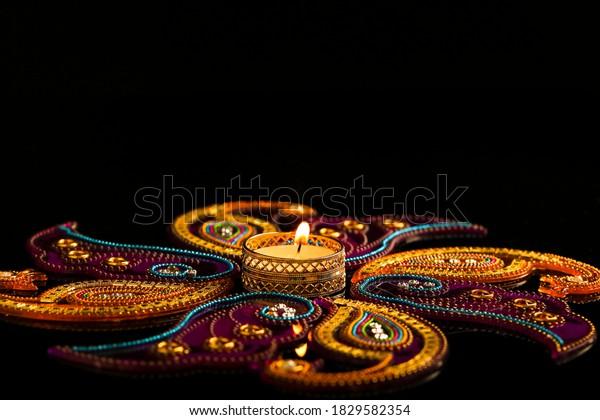 Indian festival diwali , candle on dark background