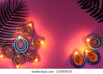 Indian festival Diwali, Diya oil lamps lit on colorful rangoli. Hindu traditional. Happy Deepavali. Copy space for text.