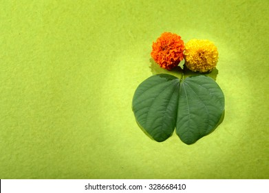 Indian Festival Dussehra, showing golden leaf and flowers on green background. Greeting card.