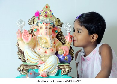 Indian Festival Ganesha celebrated by Hindu people,girl  and boy  pry the God