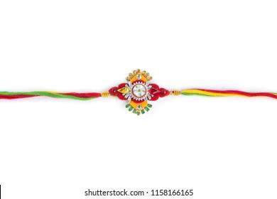 Indian festival: Raksha Bandhan background with an elegant Rakhi on a white background