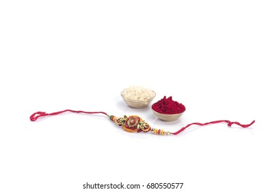 Indian festival: Raksha Bandhan background with an elegant Rakhi. A traditional Indian wrist band which is a symbol of love between Brothers and Sisters