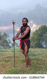 Indian fighter with spear performing Kalaripayattu marital art demonstration in Kerala, South India
