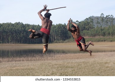 Indian fighters with bamboo stick performing Kalaripayattu Marital art demonstration in Kerala state, South India