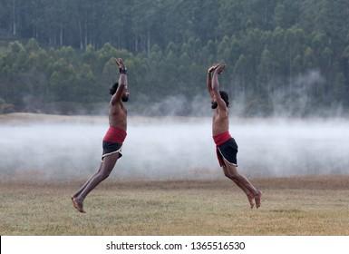 Indian fighters jumping up during Kalaripayattu Marital art demonstration in Kerala, South India