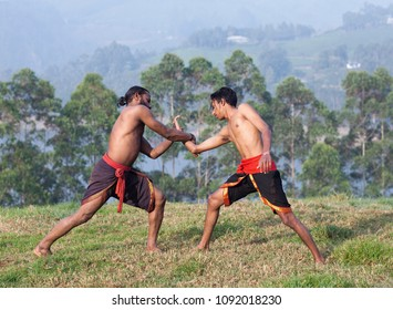 Indian fighters performing Adi Thada Hand Combat during Kalaripayattu Marital art demonstration in Kerala, South India