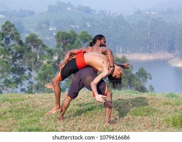 Indian fighters performing Adithada (Hand Combat) during Kalaripayattu Marital art demonstration in Kerala, South India