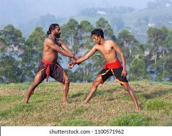 Indian fighters performing Adithada Hand Combat during Kalaripayattu Marital art demonstration in Kerala, South India
