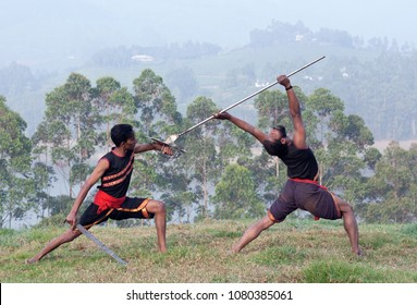 Indian fighters performing Kalaripayattu marital art demonstration in Kerala, South India