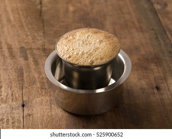 Indian filter coffee on wooden background