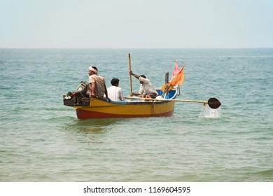 Indian fishermen in the wooden boat. March, 2016. Gokarna, Karnataka, India