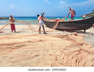 Indian fishing nets and traditional wooden boat