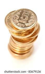 Indian Five rupees coin tower on white.